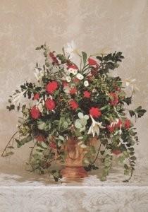 -Rood-wit kerstbloemstuk in terracotta tuinvaas- Postkaart