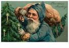 A.N.B.  -  Kerstman met een zak met cadeaus bij de kerstboom - Postkaart -  1C2148-1
