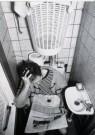 Chantal Sion (1969)  -  Man met krant op wc - Postkaart -  B2611-1