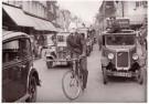 Spaarnestad Fotoarchief,  -  Fakir op fiets - Postkaart -  B3299-1