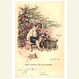 Twee kindjes bij de kerstboom